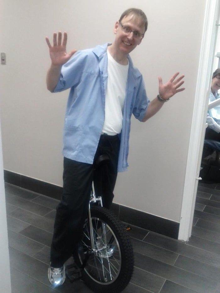 Dr. Mortensen on a monocycle.