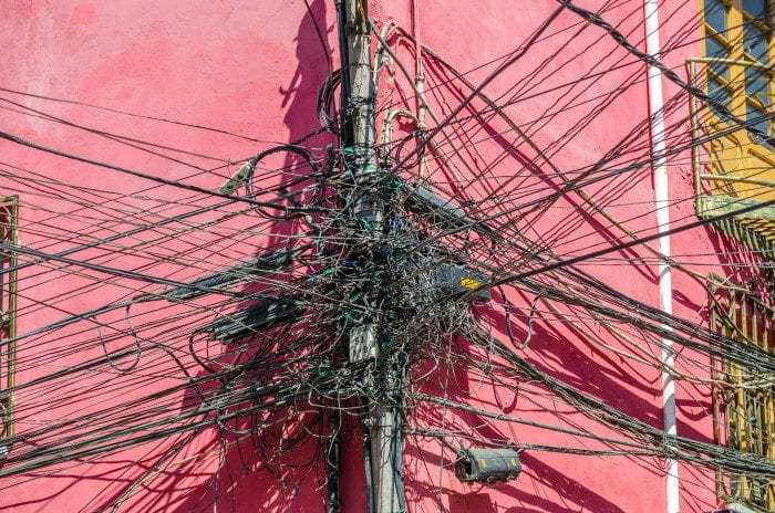 an extremely messy electricity pole.