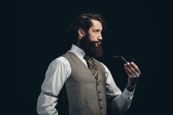 authoritative looking young man with a beard.