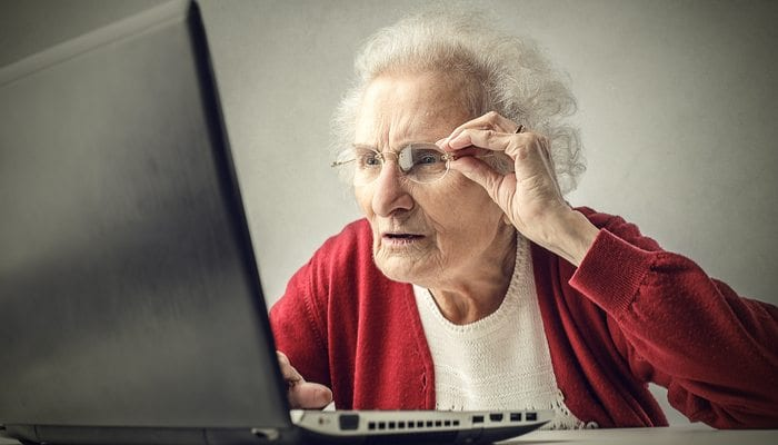 Older Patient Trying to Read Computer
