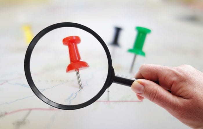 Pin in a map under a microscope referring to local medical marketing