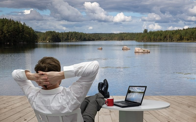 Businessman Relaxing by the Lake