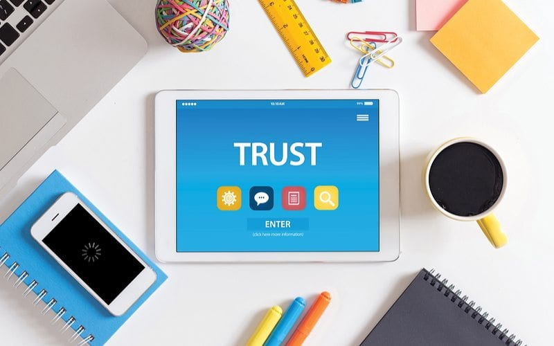 Mobile device that says trust on it