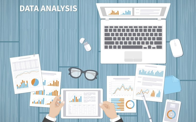 Illustration of person analyzing business data