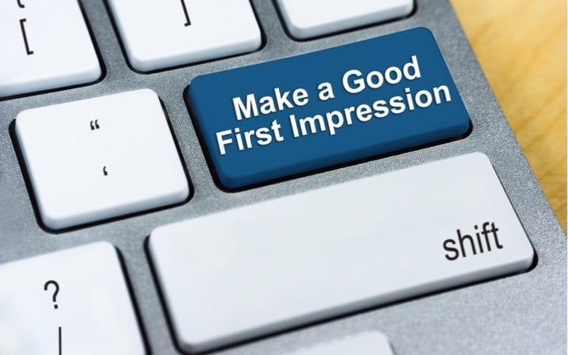 Return key on a keyboard with wording ' Make a Good First Impression'.