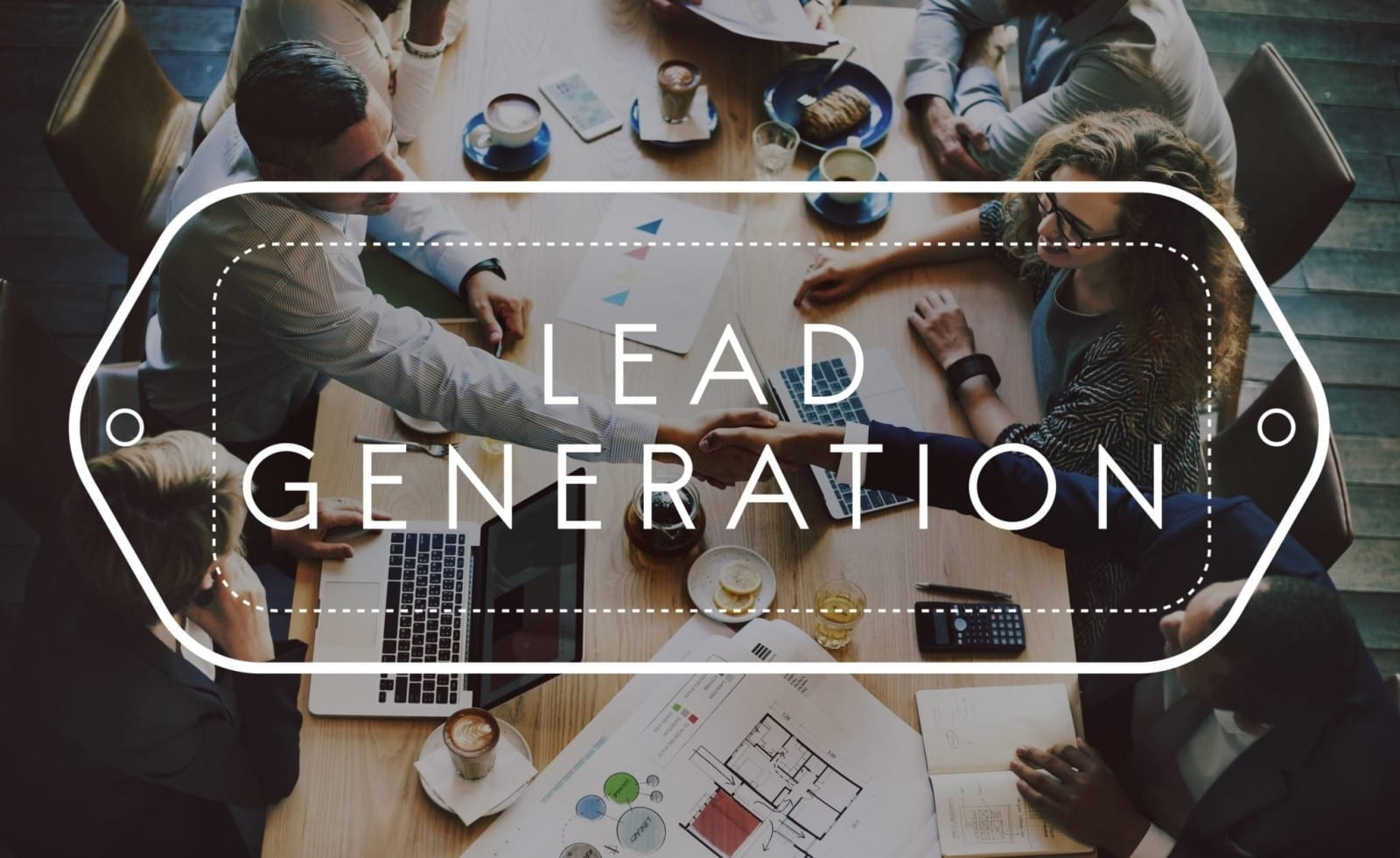 """Image of professionals seated around a table working with words """"Lead Generation"""" imposed over the image"""