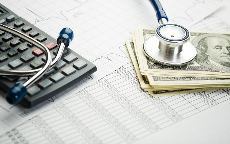 money and a stethoscope